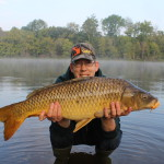A beautiful 20 lb carp caught on feed corn before work.