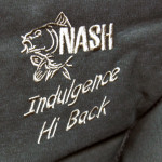 The Nash Indulgence Hi-back chair logo and stiching